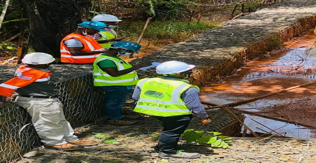Environmental Scientists Along With Deputy Executive Director Randall M. Dobayou Carry Out a Full-Scale Environmental Monitoring Assessment at Arcelor Mittal